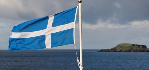 Flag of Scotland, in the back an island, Scotland, United Kingdom, Europe - ibxfun01295534.jpg