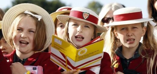 Children wait for Pope Benedict XVI at St Mary's University College Chapel in Twickenham